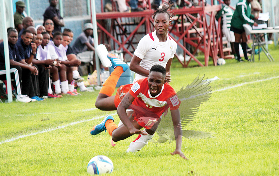 0511f88025bc8 ZAMBIA striker Barbara Banda goes down after a challenge from Namibia  defender Lina Katuta during the 2016 Cameroon Africa Women Championship  first round ...